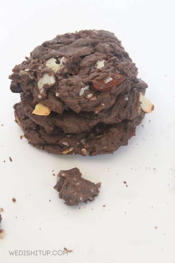 3 cookies stacked with crumbs
