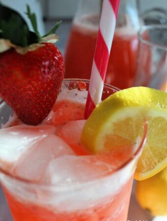 Strawberry Lemonade With Lemon Wedge