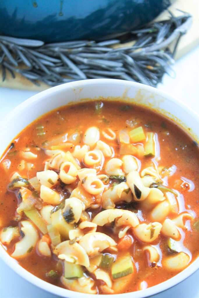 This Classic Easy Stove Top Minestrone Soup is so yummy. Your family will love all the veggies, pasta and tomato broth.
